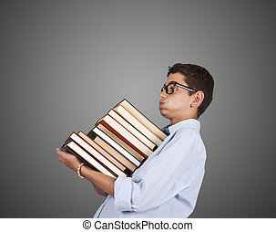 young girl with books - woman carrying stack of books...