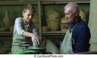 Failure - Boy failing to make a clay vase on a pottery wheel
