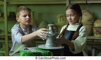 Pottery Project - Schoolchildren cooperating to work on...