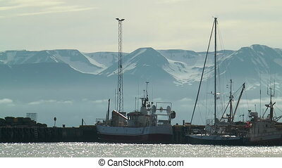 ships in harbour of husavik in icel - ships in harbor of...