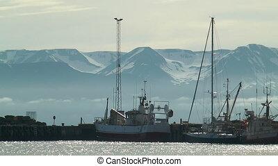 ships in harbour of husavik in icel - ships in harbor of...
