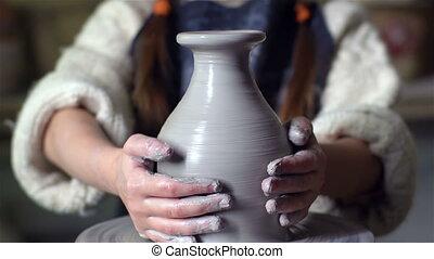 Joyful Maker - Tilt up of a cute little girl making a clay...