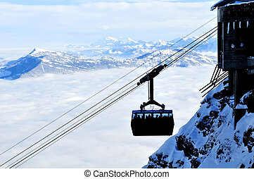 Cable car - a cable car high up a mountain in switzerland