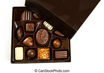 Chocolates - Gourmet chocolates in a square box on a white...