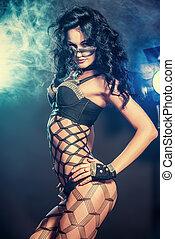 striptease - Sexual brunette girl dancing at nightclub.