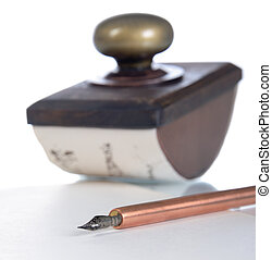ink pen and paperweight - Close-up of copper ink pen and...