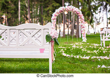 Wedding benches and flower arch for ceremony outdoors -...