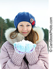 Portrait of young brunette woman in winter