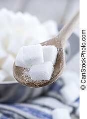 White Sugar on vintage wooden table close-up image