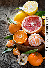 Fresh citrus fruits on rustic background, selective focus