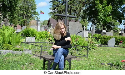 widow girl soldier grave - Sad woman sit near lover grave in...