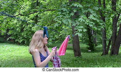 woman hang laundry - Woman hang laundry on clothesline...
