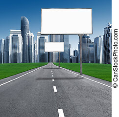 Road into town with established billboards. blank billboards...