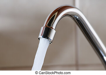Tap with Water Flowing Strongly