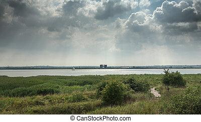Skyline over the river Thames alongside Purfleet, Grays,...