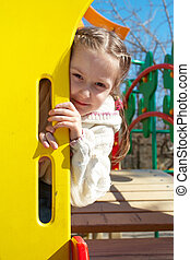 girl at playground - smiling little girl at the playground