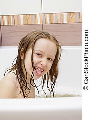 joying little girl taking a bath - joying little girl with...