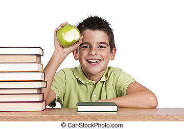 child with apples and books at school