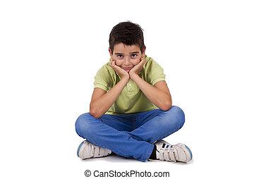 boy sitting isolated on white background