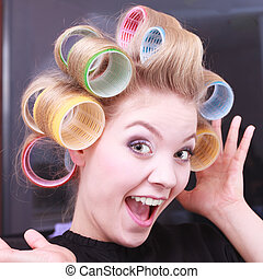 Funny happy girl curlers hair salon - Portrait of funny...