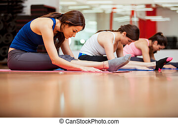 Warming up and stretching in a gym