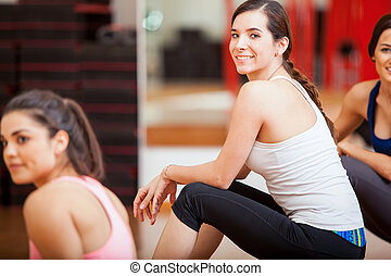 Cute young women relaxing at a gym
