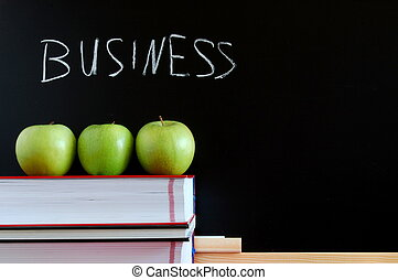 blackboard and apples - business blackboard with apples and...