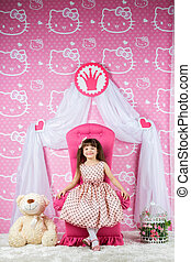 Little princess on a pink throne - Little girl princess is...