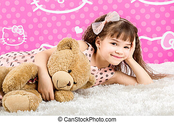 Little Girl Hugging Teddy Bear - Little girl embracing her...