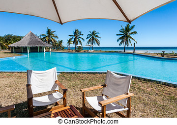 Cafe and swimming pool on the tropical beach
