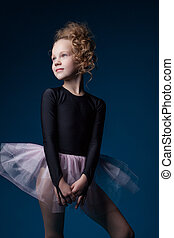 Graceful little dancer posing in studio, close-up