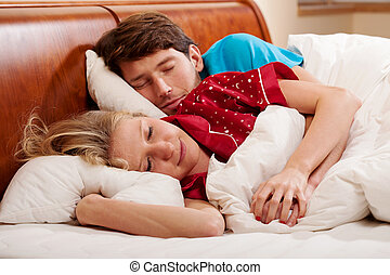 Couple sleeping - Couple hugging during sleeping in the...