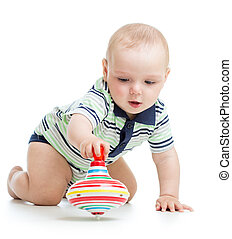 baby playing with toy whirligig