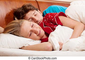 Man sleeping next his girlfriend