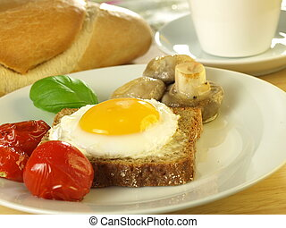 Sunny side up egg on a slice of bread with tomatoes and...