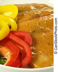 Salmon in curry sauce - Closeup of salmon in curry sauce and...