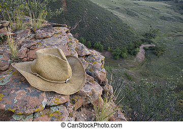 straw cowboy hat on sandstone rocks - Straw cowboy hat on...