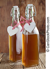 Elderberry syrup - Bottles with freshly made elderberry...