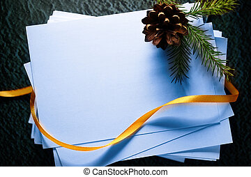 Paper cards and twig - Stack of paper cards and twig of...