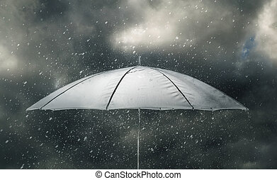Umbrella in thunderstorm - Umbrella under raindrops of...