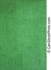 rough wood background in intense green color - very green...