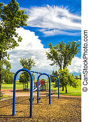 Swing Set in the Park - A blue swing set in the park