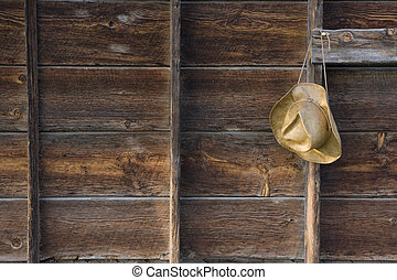 straw cowboy hat and weathered wood