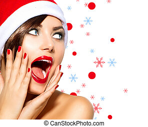 Christmas Woman Beauty Model Girl in Santa Hat over White