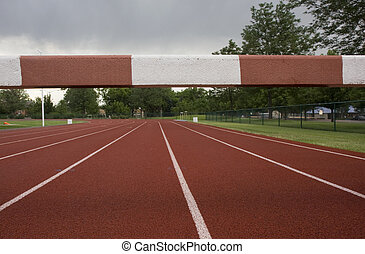 running tracks with a steeplechase  barrier across them