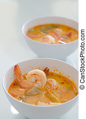 Tom Yum Goong - Thai hot and spicy seafood soup with shrimp...