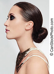 Woman with hair bun - Profile portrait of young beautiful...