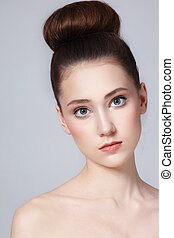 Hair bun - Portrait of young beautiful fresh slim girl with...