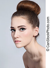 Hair bun - Portrait of young beautiful slim girl with cat...