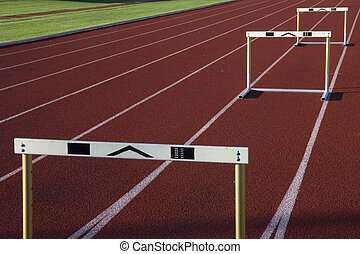 running tracks with three hurdles - red running tracks with...
